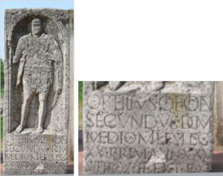 Tomba d'un legionari romà. Reproducció de la inscripció CIL XIII, 8079 de Bonna (Bonn, Alemanya) del parc arqueològic de Vetera. Exemple de l'escriptura quadrata tallada sobre pedraNota legal: © AdMeskens (2009). Creative Commons Reconeixement Compartir Igual 3.0-es. Publicada a wikimedia commons.
